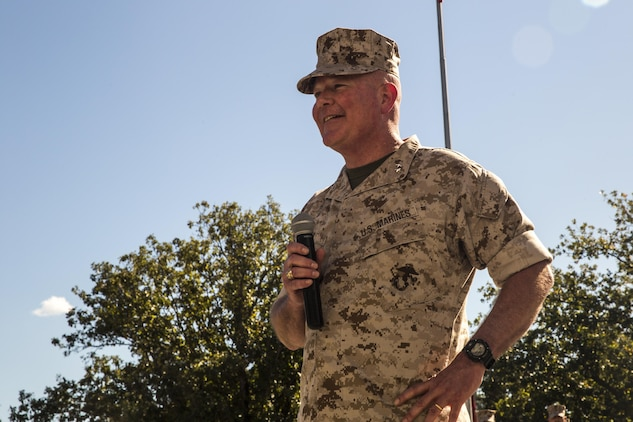 Maj. Gen. Walter L. Miller Jr., commanding general of II Marine Expeditionary Force, addresses Marines, sailors, families and friends of II MEF during a change of command ceremony at Camp Lejeune, N.C., Oct. 22, 2015. During the ceremony, Miller assumed command from Maj. Gen. William D. Beydler.