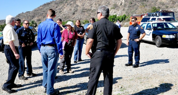 Members from U.S. Army Corps of Engineers Los Angeles District, U.S. Fish and Wildlife Service, Congresswoman Napolitano's Office, Los Angeles County Fire Department, Azuza Police Department and the City of Duarte discuss the problems in cleaning up the San Gabriel River near Sana Fe Dam Oct. 21.