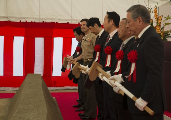 Col. Robert V. Boucher, commanding officer of Marine Corps Air Station Iwakuni, Japan, and Japanese dignitaries wait for the command to break dirt at the ground breaking ceremony at Atagoyama Baseball Field in Iwakuni City, Oct. 15, 2015. The Government of Japan purchased Atagoyama in 2012 in support of the Iwakuni Runway Relocation Project. The site provided the dirt and sand used to construct Iwakuni's new runway.