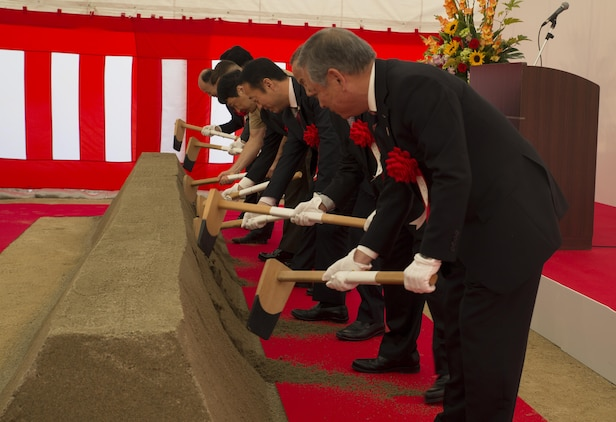 Japanese dignitaries break the dirt at the Atagoyama Baseball Field ground breaking ceremony in Iwakuni City, Japan, Oct. 15, 2015. Atagoyama Baseball Field is thanks to the city for their understanding and cooperation in the continuing support of the presence and operations of the U.S. military installation.