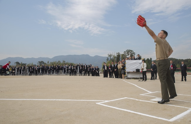 Col. Robert V. Boucher, commanding officer of Marine Corps Air Station Iwakuni, Japan, catches Yoshihika Fukuda's, mayor of Iwakuni City, first pitch at the ground breaking ceremony of Atagoyama Baseball Field in Iwakuni City, Oct. 15, 2015. The baseball field is designed for the shared use with local citizens and U.S. forces.