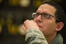 U.S. Air Force Airman 1st Class Joel Castro, 52nd Aircraft Maintenance Squadron, aerospace propulsion, receives his flu mist during a disease containment plan exercise Oct. 21, 2015, at Spangdahlem Air Base, Germany. The flu mist or flu shot is an annual requirement for service members. (U.S. Air Force photo by Staff Sgt. Christopher Ruano/Released)