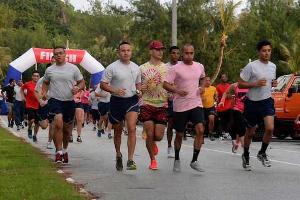 Airmen participate in the Pink 5K run Oct. 21, 2015, at Tarague Beach on Andersen Air Force Base, Guam. More than 100 people attended the run to raise awareness about breast cancer. (U.S. Air Force photo by Airman 1st Class Alexa Ann Henderson/Released)