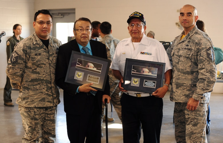 """Gilbert Guerrero, second from left, Guadalupe Center Inc. vice president of youth development and supplemental education, and Paul Rojas, Guadalupe Center Inc. board president, stand with Master Sgt. Gerardo Valdez, Jr., left, 509th Maintenance Squadron aircraft fuel systems section chief, and Senior Master Sgt. Neftali Nieves, right, 509th Bomb Wing command post superintendent, after being presented with a token of appreciation Oct. 16, 2015, at Whiteman Air Force Base, Mo. The closing ceremony for the Hispanic American Heritage Month also featured a """"Latin night"""" with authentic Latin music and dancing. (U.S. Air Force photo by Airman 1st Class Jazmin Smith/Released)"""