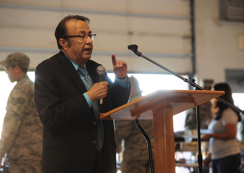 Gilbert Guerrero, Guadalupe Center Inc. vice president of youth development and supplemental education, speaks with members of Team Whiteman during the Hispanic American Heritage Month luncheon Oct. 16, 2015, at Whiteman Air Force Base, Mo. Guerrero spoke about how his organization provides services to Latino immigrants and the importance of investing time in developing schools for youth. (U.S. Air Force photo by Airman 1st Class Jazmin Smith/Released)