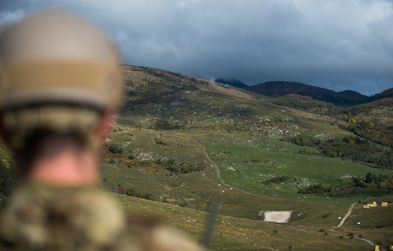 U.S. Air Force Senior Airman Gage Duvall, 2nd Air Support Operations Squadron joint terminal attack controller in training, watches artillery rounds land during Rock Proof V Oct. 16, 2015, at Pocek Training Range, near Postojna, Slovenia. Rock Proof is a U.S. Army multilateral exercise designed to improve interoperability between U.S and Slovenian militaries. (U.S. Air Force photo/Staff Sgt. Armando A. Schwier-Morales)