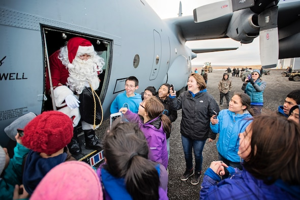JOINT BASE ELMENDORF-RICHARDSON, Alaska -- Children in Savoonga, Alaska, greet Santa Claus as he emerges from a C-130 Hercules aircraft from the 144th Airlift Squadron, Alaska Air National Guard, Oct. 16, during this year's Operation Santa mission. This year marks the 59th year of the program, which serves to bring Christmas to underserved, remote villages across Alaska each year. (U.S. National Guard photo by Staff Sgt. Edward Eagerton)
