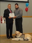Richard Ellis, DLA Troop Support deputy commander (left) thanks William Pagan (right), a Subsistence TVLS and his service dog, Oprah, for presenting at the DLA Troop Support CFC kickoff Oct. 19 in Philadelphia.