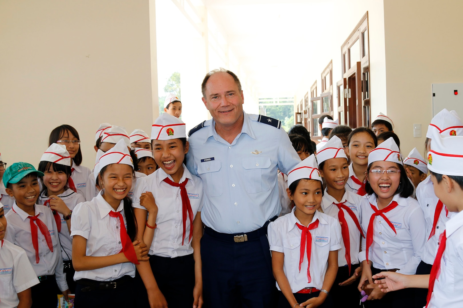 Brig. Gen. Michael E. Stencel, adjutant general, Oregon, poses with students at their new intermediate school in Phu Tinh village in the Quang Nam Province of Vietnam, Oct. 21,  2015, following a ribbon cutting ceremony. The new school was built in cooperation between the U.S. and Vietnam and has a secondary-use as a shelter during natural disasters.
