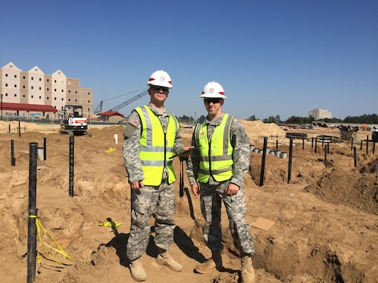 Capt. Joshua Moore (right) and 2nd Lt. Thomas Zarack (left), both part of the Technical Engineer Competency Development Program, pose at the site of Fort Gordon's $66 million Advanced Individual Training Phase II Barracks and Ground Source Heat Transfer Project Oct. 16. The pair work as part of the TEC-DP which places junior engineers at USACE districts to gain technical expertise while filling key billets within USACE.