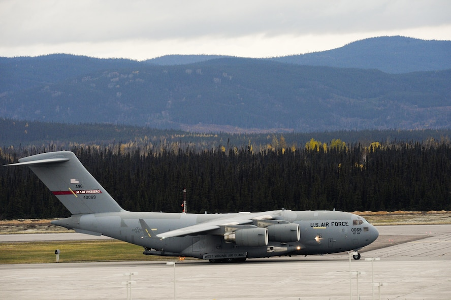 A C-17 Globemaster III lands at 5 Wing Goose Bay, Canada, Oct. 14, 2015. The aircraft carried personnel and cargo participating in Vigilant Shield 16. From Oct. 15-26, approximately 700 members from the Canadian Armed Forces, the U.S. Air Force, the U.S. Navy, and the U.S. Air National Guard are deploying to Iqaluit, Nunavut, and 5 Wing Goose Bay, Newfoundland and Labrador, for exercise Vigilant Shield 16. (U.S. Air Force photo/Tech. Sgt. Joshua J. Garcia)
