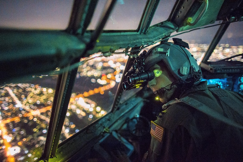 Capt. Thomas Bernard, a 36th Airlift Squadron C-130 Hercules pilot, performs a visual confirmation with night vision goggles during a training mission over the Kanto Plain, Japan, Oct. 14, 2015. Crews from Yokota Air Base, Japan, regularly conduct night flying operations to ensure they're prepared to respond to a variety of contingencies throughout the Indo-Asia Pacific region. (U.S. Air Force photo/Osakabe Yasuo)