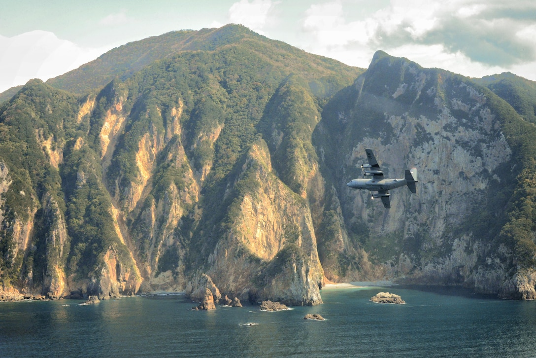 A C-130 Hercules flies over Izu Peninsula, Japan, Oct. 14, 2015. Performing regular in-flight operations gives all related personnel real-world experience to stay prepared for contingency situations and regular operations. (U.S. Air Force photo/Airman 1st Class Elizabeth Baker)