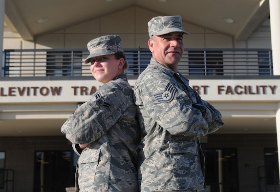 Airman 1st Class Breanna McDonald and Staff Sgt. Michael McDonald, 336th Training Squadron students, pose for a photo at the Levitow Training Support Facility parade field, Oct. 15, 2015, Keesler Air Force Base, Miss. The dad and daughter both went through cyber courses at the 336th TRS at the same time and will be stationed with each other the Air National Guard's 178th Wing based out of Springfield, Ohio. (U.S. Air Force photo by Senior Airman Holly Mansfield)