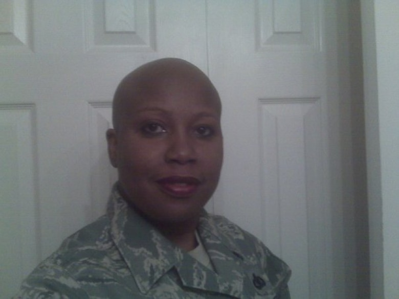 The results of Chief Master Sgt. Yolanda Jennings' chemotherapy treatment, when she had just taken her wig off for the first time at work. (Courtesy photo)