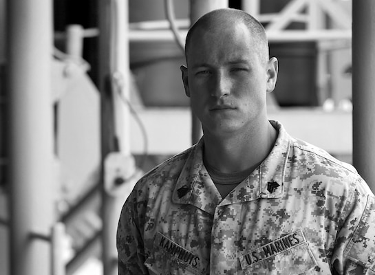 Marine Corps Sgt. Jan Kamphuis, an air traffic controller with Marine Medium Tiltrotor Squadron 162, poses Oct. 10, 2015, aboard the USS Kearsarge. Kamphuis is the most recent recipient of the Sgt. Maj. Frederick B. Douglass award, given annually by the Marine Corps League to the Marine who demonstrates superior qualities in the Marine Corps aviation community. U.S. Marine Corps photo illustration by Cpl. Joshua W. Brown