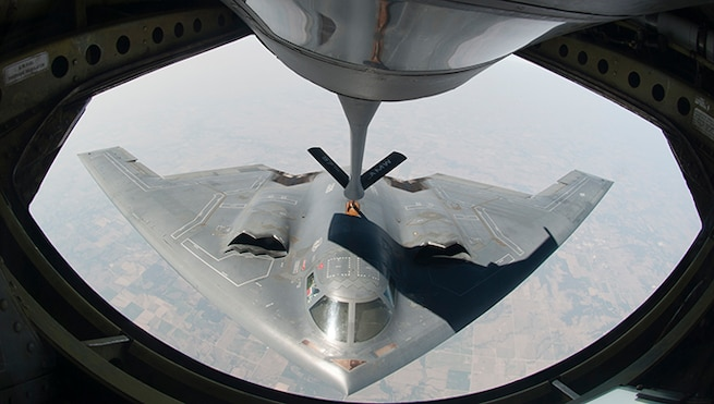 ALTUS AIR FORCE BASE, Okla. – A KC-135 Stratotanker from Altus AFB refuels a B-2 Spirit Stealth Bomber from Whiteman AFB, Mo. during a refueling training mission, Aug. 29, 2012. The KC-135 Stratotanker aircrew was assigned to refuel a B-2 Spirit Stealth Bomber in support of a training mission. (U.S. Air Force photo by Airman 1st Class Franklin R. Ramos / 97th Air Mobility Wing / Released)