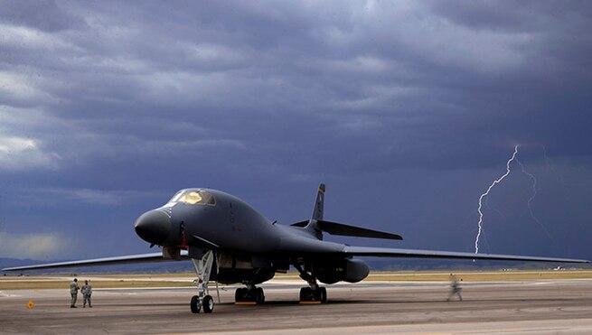 ELLSWORTH AIR FORCE BASE, S.D. - Lightning strikes behind a B-1B Lancer during an evening thunderstorm, Sept. 9. The 28th Bomb Wing maintains a fleet of 28 B-1s. (U.S. Air Force photo/Senior Airmen Corey Hook)