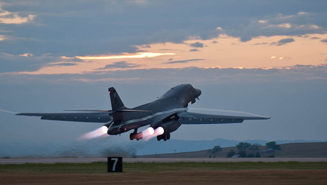 A B-1 bomber rumbles down the flightline at Ellsworth Air Force Base, S.D. , July 24, 2012 as part of a training mission. Each of the B-1's four engines is capable of producing 30,000-plus pounds of thrust. (U.S. Air Force photo by Airman 1st Class Zachary Hada/Released)