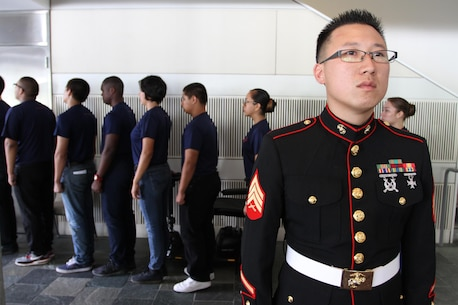 "Sgt. Kevin Han, recruiter with Recruiting Sub Station Hollywood, Calif., waits to give the command ""march"" to poolees, individuals who have taken the oath of enlistment, during a World War II Victory Luncheon and Celebration at the Skirball Cultural Center in Los Angeles, Oct. 14, 2015. During the celebration, poolees from all branches of the military participated in a swear-in-ceremony, and spoke to World War II veterans about their experiences in the military. (U.S. Marine Corps photo by Sgt. Alicia R. Leaders/Released)"
