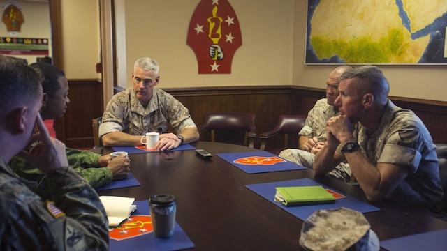 Leaders from 2nd Marine Division, II Marine Expeditionary Force, U.S. Marine Forces-South and the Belize Defence Force participate in a roundtable discussion at II MEF, Marine Corps Base Camp Lejeune, N.C., Oct. 22, 2015. The purpose of the visit was to assess the capabilities of U.S. forces, discern opportunities for Belize forces to train alongside Marines and sustain enduring partnerships between the two countries in their efforts to counter transnational organized crime. (From left, clockwise: U.S. Army Lt. Col. Robert Ramsey, U.S. military liaison officer; Brig. Gen. David Jones, commander of the Belize Defence Force; U.S. Marine Corps Maj. Gen. Brian Beaudreault, commanding general of 2nd Marine Division; U.S. Marine Corps Col. Barry Fitzpatrick, chief of staff of 2nd Marine Division; U.S. Marine Corps Brig. Gen. Eric Smith, commander of U.S. Marine Forces-South.)