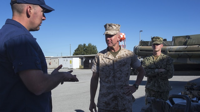 U.S. Marine Corps Brig. Gen Eric Smith, commander of U.S. Marine Forces-South, speaks to leaders of the Special Missions Training Center during the Belize Delegation visit to Marine Corps Base Camp Lejeune, N.C., Oct. 22, 2015. The purpose of the visit was to assess the capabilities of U.S. forces, discern opportunities for Belize forces to train alongside Marines and sustain enduring partnerships between the two countries in their efforts to counter transnational organized crime. (From left to right: U.S. Coast Guard Cmdr. Matthew Baer, executive officer of the Special Missions Training Center; U.S. Marine Corps Brig. Gen. Eric Smith, commander of U.S. Marine Forces-South; U.S Navy Lt. Kerry Michaud, officer-in-charge for the Center for Security Forces Learning Site Camp Lejeune.)