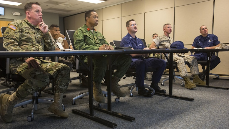 Leaders from 2nd Marine Division, II Marine Expeditionary Force, U.S. Marine Forces-South and the Belize Defence Force participate in a roundtable discussion at II MEF, Marine Corps Base Camp Lejeune, N.C., Oct. 22, 2015. The purpose of the visit was to assess the capabilities of U.S. forces, discern opportunities for Belize forces to train alongside Marines and sustain enduring partnerships between the two countries in their efforts to counter transnational organized crime. (From left to right: U.S. Army Lt. Col. Robert Ramsey, U.S. military liaison officer; Brig. Gen. David Jones, commander of the Belize Defence Force; U.S. Coast Guard Capt. Jonathon Riffe, commanding officer of the Special Missions Training Center; U.S. Marine Corps Brig. Gen. Eric Smith, commander of U.S. Marine Forces-South; U.S. Coast Guard Cmdr. Matthew Baer, executive officer of the Special Missions Training Center.)
