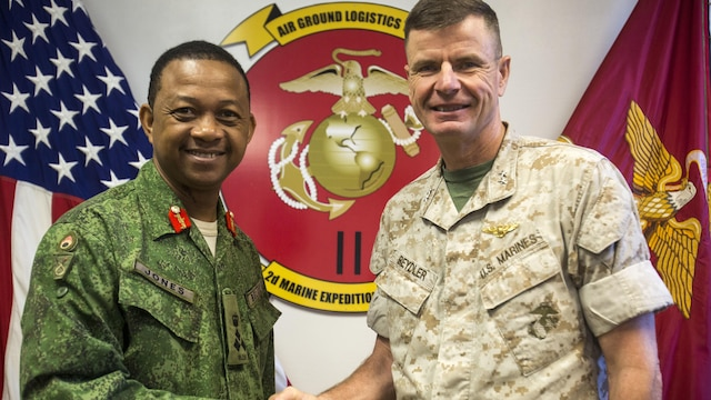 Brig. Gen David Jones, commander of the Belize Defence Force, and Maj. Gen. William Beydler, former commanding general of II Marine Expeditionary Force, meet during a visit to Marine Corps Base Camp Lejeune, N.C., Oct. 22, 2015. The purpose of the visit was to assess the capabilities of U.S. forces, discern opportunities for Belize forces to train alongside Marines and sustain enduring partnerships between the two countries in their efforts to counter transnational organized crime.