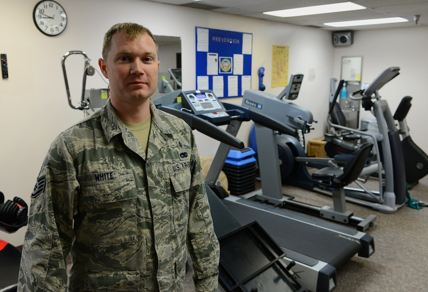 U.S. Air Force Staff Sgt. Michael White, a 354th Medical Group physical therapy technician, takes a break from his busy day Oct. 22, 2015, at Eielson Air Force Base, Alaska. White said his favorite part of his job is helping people heal so they can continue to fight for the mission at hand. (U.S. Air Force photo by Airman 1st Class Cassandra Whitman/Released)