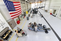 Airmen assigned to the aerospace ground equipment (AGE) shop perform maintenance on a bomb lift at Whiteman Air Force Base, Mo., Oct. 21, 2015. The mission of the AGE shop is to maintain and provide equipment for aircraft support with efficient and timely service. (U.S. Air Force photo by Senior Airman Keenan Berry/Released)