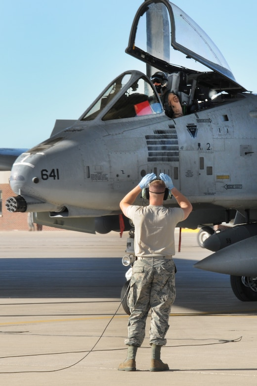 151022-Z-YW189-002 - -A crew chief with the 127th Aircraft Maintenance Squadron marshals an A-10 Thunderbolt II at Selfridge Air National Guard Base, Mich., after a six month deployment on October 22, 2015. The A-10 returned from a six month deployment from southwest Asia in support of U.S. Central Command's Operations Inherent Resolve. (U.S. Air National Guard photo by Staff Sgt. Samara Taylor/Released)