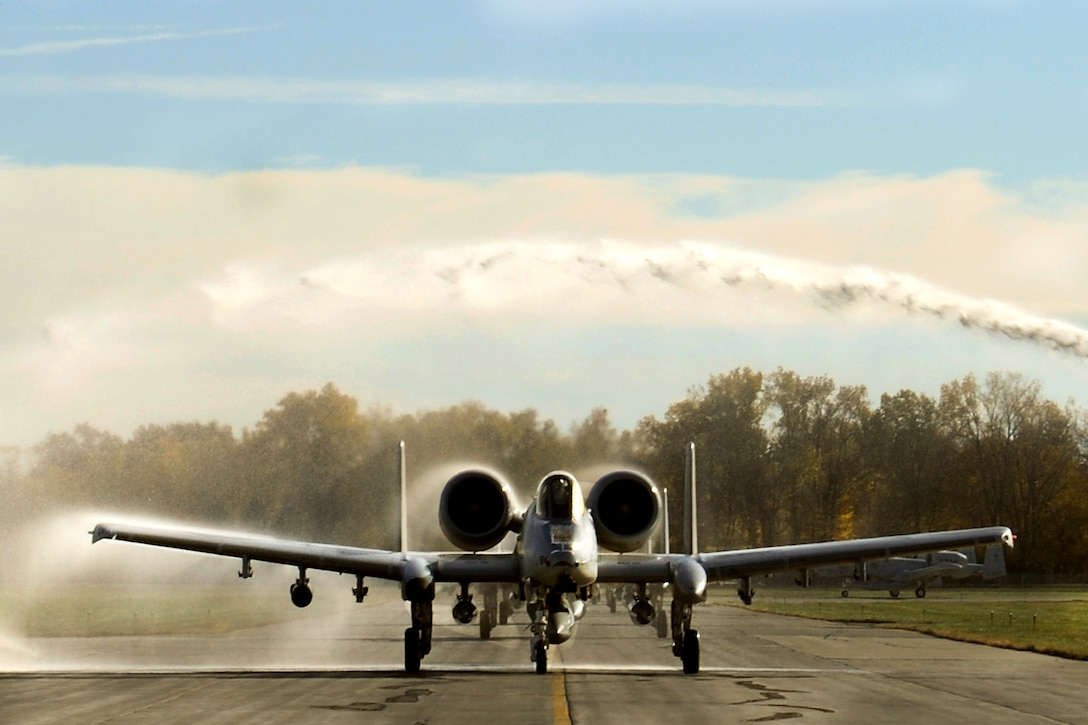 151022-Z-EZ686-143 -- An A-10 Thunderbolt II aircraft of the 127th Wing's 107th Fighter Squadron from Selfridge Air National Guard Base, Mich., receives a warm welcome home to the base on October 22, 2015, after a six month deployment to Southwest Asia in support of U.S. Central Command's Operations Inherent Resolve. (U.S. Air National Guard photo by Master Sgt. David Kujawa)
