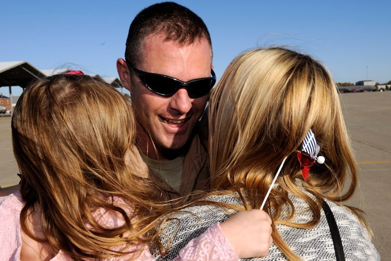 151022-Z-EZ686-352 – A pilot with the 127th Wing's 107th Fighter Squadron from Selfridge Air National Guard Base, Mich., reunites with his family after a six month deployment on October 22, 2015.  Ten A-10 Thunderbolt II aircraft returned from a six month deployment to Southwest Asia in support of U.S. Central Command's Operation Inherent Resolve.   (U.S. Air National Guard photo by Master Sgt. David Kujawa)