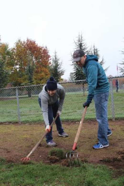 "Airmen from the Joint Base Lewis-McChord's 627th Air Base Group help fix the edging on Tumwater's Pioneer Park baseball fields during the ""Third Thursday in Thurston"" Oct. 15."