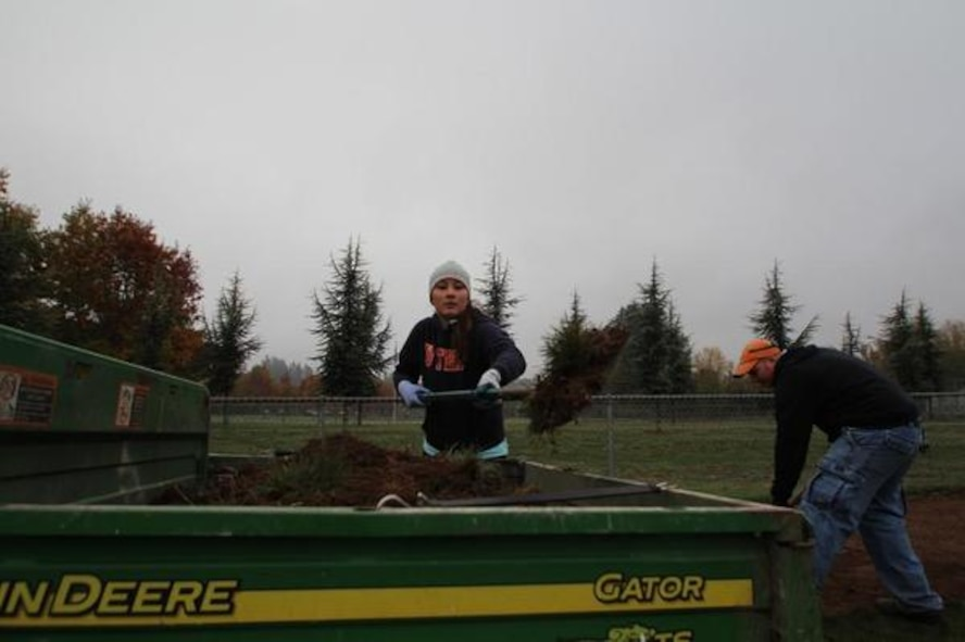 """Airmen from the Joint Base Lewis-McChord's 627th Air Base Group help fix the edging on Tumwater's Pioneer Park baseball fields during the """"Third Thursday in Thurston"""" Oct. 15."""