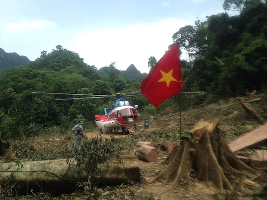 A Vietnamese helicopter in a jungle clearing, just after dropping off AFN's MC2(SW) Billy Ho on his mission to account for U.S. Service members currently listed as POW or MIA since the Vietnam War (DPAA Photo)