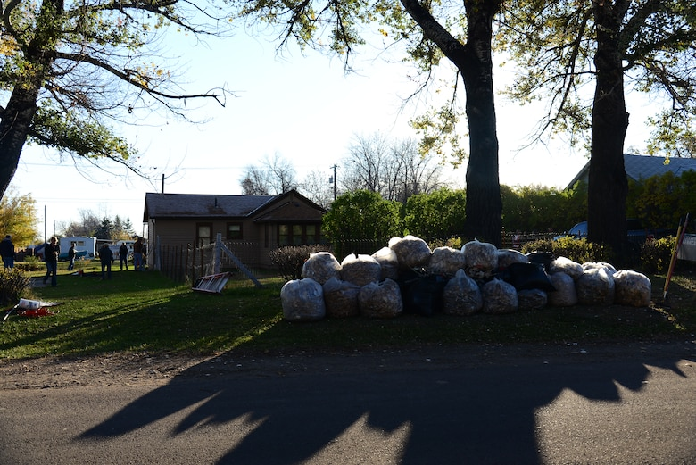 Collected leaves are stacked in a Great Falls, Mont. yard Oct. 23, 2015, as part of the Day of Caring. Airmen from Malmstrom Air Force Base and federal employees volunteered to perform household chores. (U.S. Air Force photo/Airman 1st Class Magen M. Reeves)