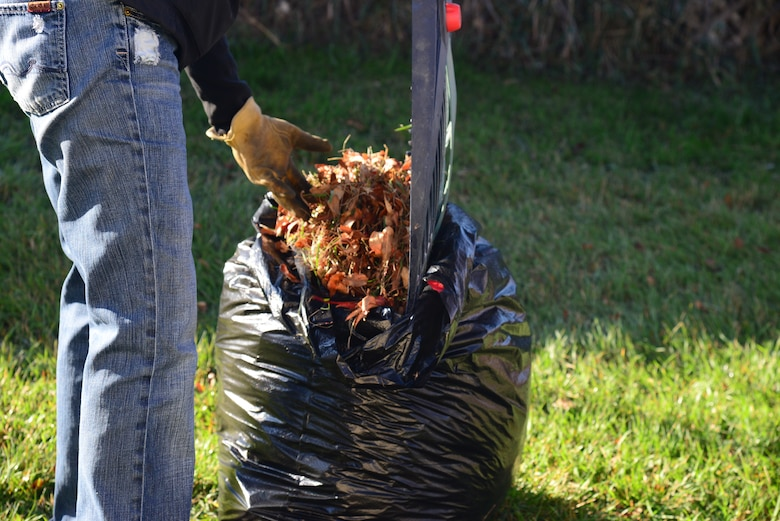 Airmen from Malmstrom Air Force Base and federal employees gathered for the Day of Caring, Oct. 23, 2015, in the Great Falls, Mont., community. The Day of Caring is an annual volunteer opportunity for individuals to help local community members with household chores, such as raking leaves, washing windows, trimming trees and changing lightbulbs. (U.S. Air Force photo/Airman 1st Class Magen M. Reeves)