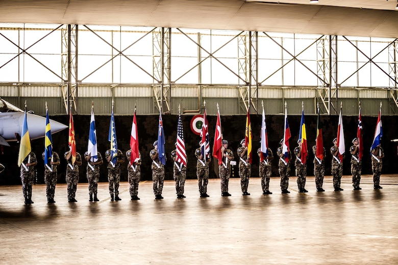 The Trident Juncture 2015 opening ceremony in Trapani, Italy, included a parade of flags of participating nations. (Photo by Miks Uzans/Released)