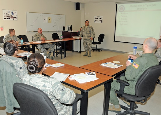 Technical Sergeant Luis Torres, 4th Fighter Wing, briefs new Resilience Training Assistants from the 143d Airlift Wing, 102nd Network Warfare Squadron and the 282nd Combat Communications Squadron, Rhode Island Air National Guard at Quonset Air National Guard Base, North Kingstown, Rhode Island. National Guard Photo by Tech Sgt Jason Long (RELEASED)