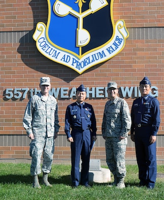 From left to right: Lt. Col. James Weaver, 2nd Weather Group deputy commander, Col. Jong Mo Kim, Republic of Korea Air Force Weather Wing commander, Col. William Carle, 557th WW commander, and Lt. Col. Sung-Hoon An, ROKAF WW, stand for a photo outside the 557th WW building Oct.14 on Offutt Air Force Base, Neb. This was Col. Jong Mo Kim's first visit since talking commander and also the first visit from the ROKAF since the changeover from the Air Force Weather Agency to the 557th WW.  (U.S. Air Force photo by Kendra Wilkinson/Released)