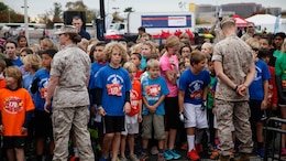 Children wait for the start of the Marine Corps Marathon Kid's Run Oct. 24, 2015, at the Pentagon in Arlington, Virginia. More than 3,500 Children participated in the one-mile event. The run is organized to promote physical fitness and morale for the children and the community.