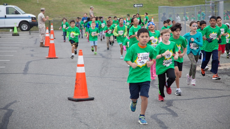 Children run through the Pentagon's north parking lot during the Marine Corps Marathon Kid's Run Oct. 24, 2015. More than 3,500 Children participated in the one-mile event. The run is organized to promote physical fitness and morale for the children and the community.