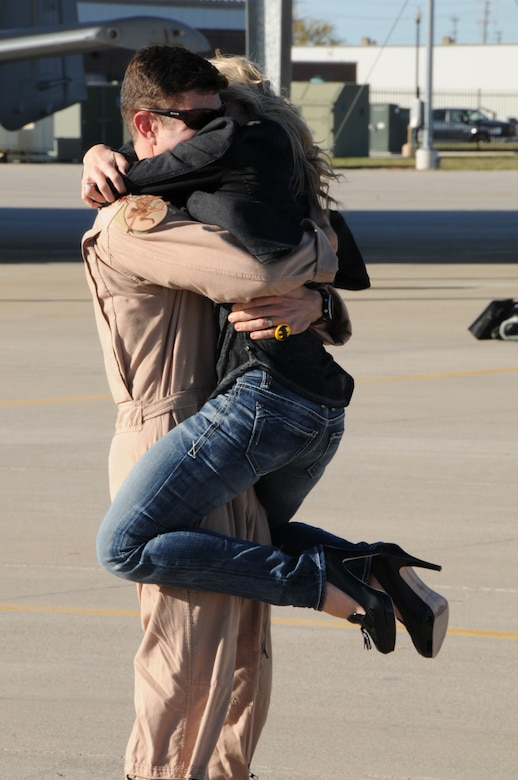 151022-Z-YW189-019– A pilot with the 127th Wing's 107th Fighter Squadron from Selfridge Air National Guard Base, Mich., reunites with his family after a six month deployment on October 22, 2015. Ten A-10 Thunderbolt II aircraft returned from a six-month deployment to Southwest Asia in support of U.S. Central Command's Operation Inherent Resolve. (U.S. Air National Guard photo by Staff Sgt. Samara Taylor)