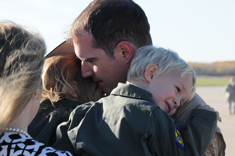 151022-Z-YW189-015– A pilot with the 127th Wing's 107th Fighter Squadron from Selfridge Air National Guard Base, Mich., reunites with his family after a six month deployment on October 22, 2015. Ten A-10 Thunderbolt II aircraft returned from a six-month deployment to Southwest Asia in support of U.S. Central Command's Operation Inherent Resolve. (U.S. Air National Guard photo by Staff Sgt. Samara Taylor)