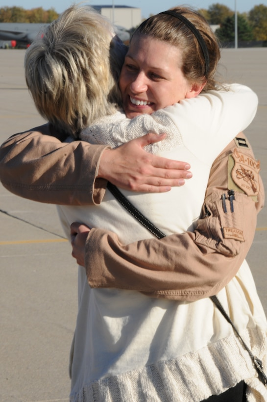 151022-Z-YW189-026 - – A pilot with the 127th Wing's 107th Fighter Squadron from Selfridge Air National Guard Base, Mich., reunites with her family after a six month deployment on October 22, 2015. Ten A-10 Thunderbolt II aircraft returned from a six-month deployment to Southwest Asia in support of U.S. Central Command's Operation Inherent Resolve. (U.S. Air National Guard photo by Staff Sgt. Samara Taylor)