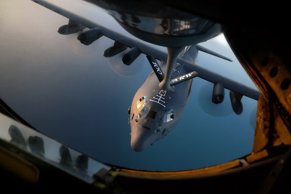 A U.S. Air Force MC-130J Commando II from RAF Mildenhall, England, takes on fuel from a KC-135 Stratotanker from RAF Mildenhall, England, Oct. 22, 2015, over the Atlantic Ocean. The two aircraft were training in exercise Trident Juncture, an exercise designed to help militaries respond more effectively to regional crises with NATO allies and partners – improving security of borders, ensuring energy security and countering threats of terrorism. (U.S. Air Force photo by Senior Airman Christine Halan/Released)