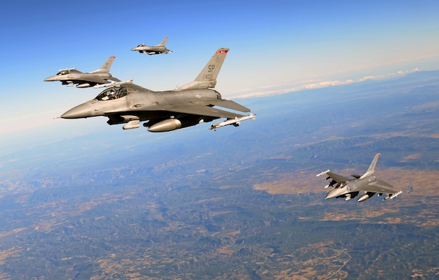 U.S. Air Force F-16 Fighting Falcons from Spangdahlem Air Base, Germany, fly in formation, Oct. 22, 2015, over Spain. The aircraft received fuel from a KC-135 Stratotanker from RAF Mildenhall, England, as part of Exercise Trident Juncture. (U.S. Air Force photo by Senior Airman Christine Halan/Released)