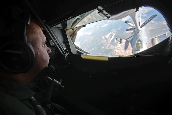 U.S. Air Force Master Sgt. Larry Nahalea, 351st Air Refueling Squadron boom operator, refuels an F-16 Fighting Falcon from Spangdahlem Air Base, Germany, Oct. 22, 2015 over Spain. Nahalea refueled nine aircraft during this particular mission as part of Exercise Trident Juncture. (U.S. Air Force photo by Senior Airman Christine Halan/Released)