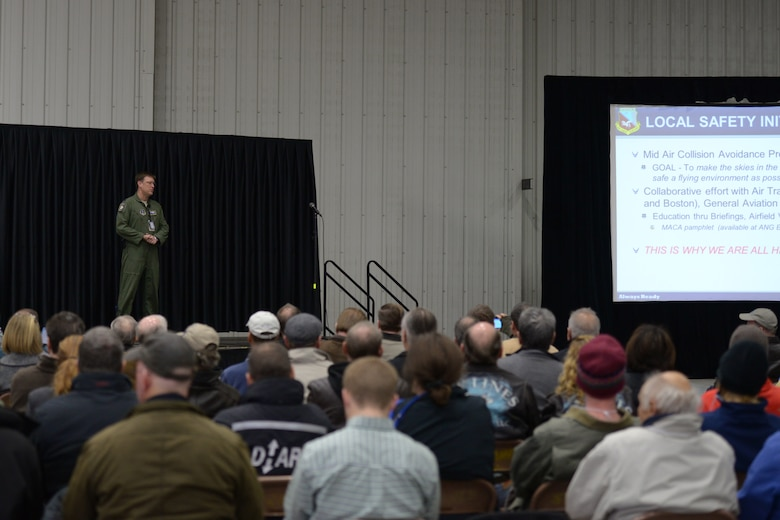 Lt. Col. Jeff Denton, 157th Air Refueling Wing Chief of Safety, talks to attendees of the New England Mid-Air Collision Avoidance Seminar at Portsmouth International Airport, Portsmouth, N.H. October 25, 2015. The seminar brought together military members and civilians to discuss how to avoid mid-air collisions between military and civilian aircrafts and to give civilian pilots an insight in to military aircrafts, operations and flight patterns. Portions of this image were blurred to protect personal identifiable information. (N.H. Air National Guard photo by Airman Ashlyn J. Correia/Released)